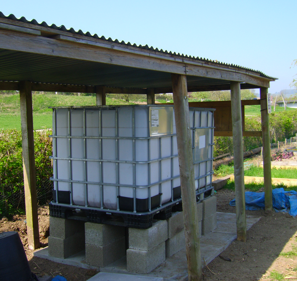 Two IBCs Positioned for Rainwater Catchment